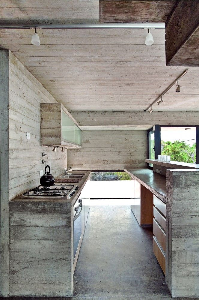 Concrete kitchen at Villa Gesell, Buenos Aires Province, Argentina by BAK Architects