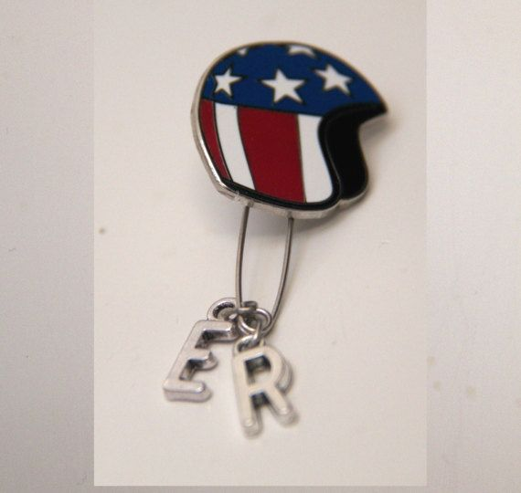 EASY RIDER SINGLE MONO EARRING.     RECEIVE 10% OFF WITH CODE: WELCOMESALE2017    THE STORY:  Dennis Hoppers 1969 revolutionary film Easy Rider continues to be a source of major inspiration at MITCHUMVSBOGART. Dennis Hopper is the icon above all others!  This single earring is modelled on the original Captain American Helmet worn by Peter Fonda in Easy Rider. The silver charms spell E.R, which stands for Easy Rider.