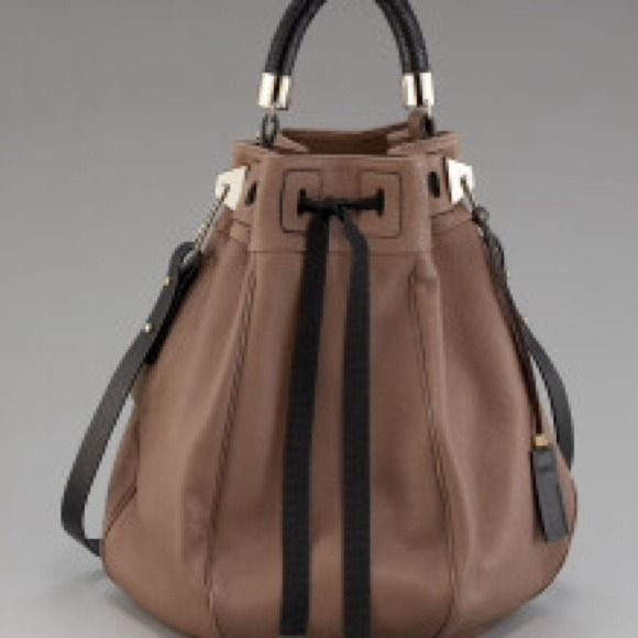 """Pauric Sweeney Toffee Calfskin Leather Bucket Bag Pauric Sweeney Toffee Calfskin leather handbag w/ black accents & golden hardware. Tubular, woven top handle; shoulder strap. 15""""H x 20""""W x 8""""D  3 inside pockets. Canvas lining. Pristine condition.  NWT Pauric Sweeney Bags"""
