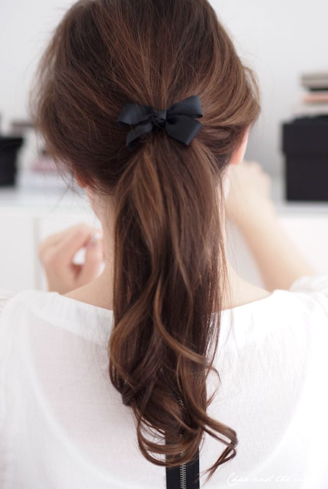 Softly-curled ponytail, topped off with a bow.