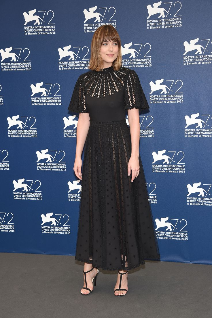 Dakota Johnson wearing a Valentino Spring 2016 gown at the 'Black Mass' photocall during the 72nd Venice Film Festival on September 4th 2015.