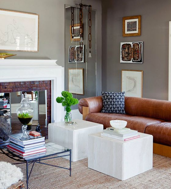 Gabriel Hendifar living room, gray walls, mirrors, leather sofa, cube tables, fireplace