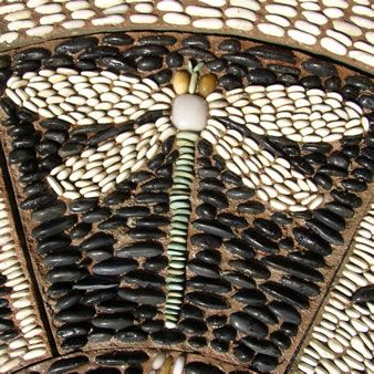 Pebble Mosaic dragonfly  Dragonfly medicine is about the breaking of illusions, especially those illusions that prevent growth and maturity. Dragonfly is the bringer of visions of power. Flighty and carefree dragonflies symbolize whirlwind, swiftness and activity.