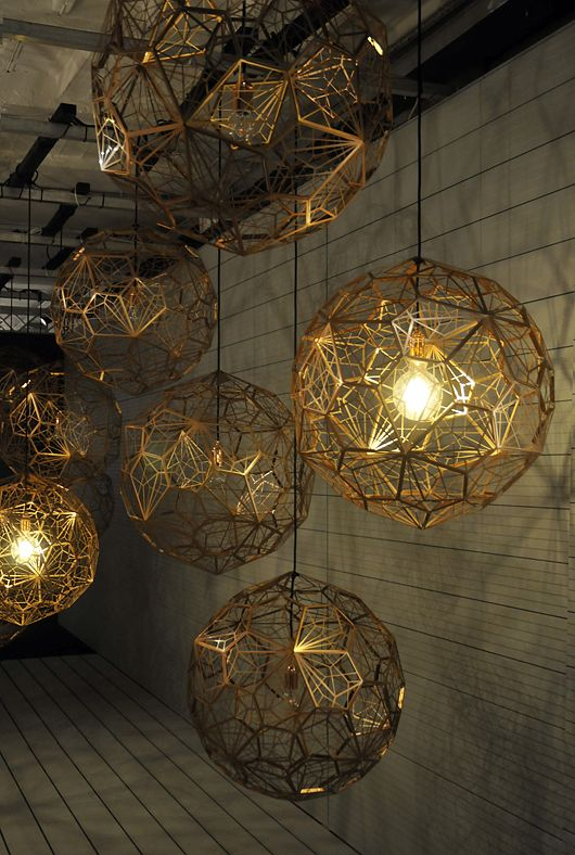 Tom Dixon lights - geometric, gorgeous as a cluster if you have the space...