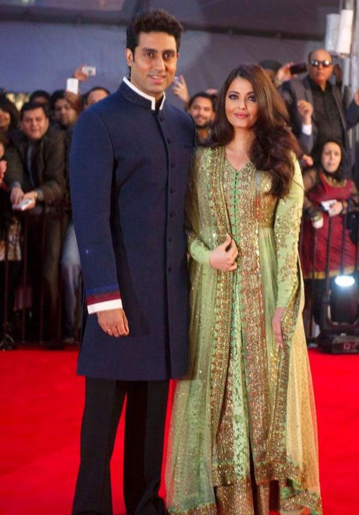 Vancouver's inaugural @The Times of India Film Awards #TOIFA, April, 13 ✇ Abhishek Bachchan with Aishwarya in gorgeous green #Anarkali dress featuring delicate gold and copper embroidery