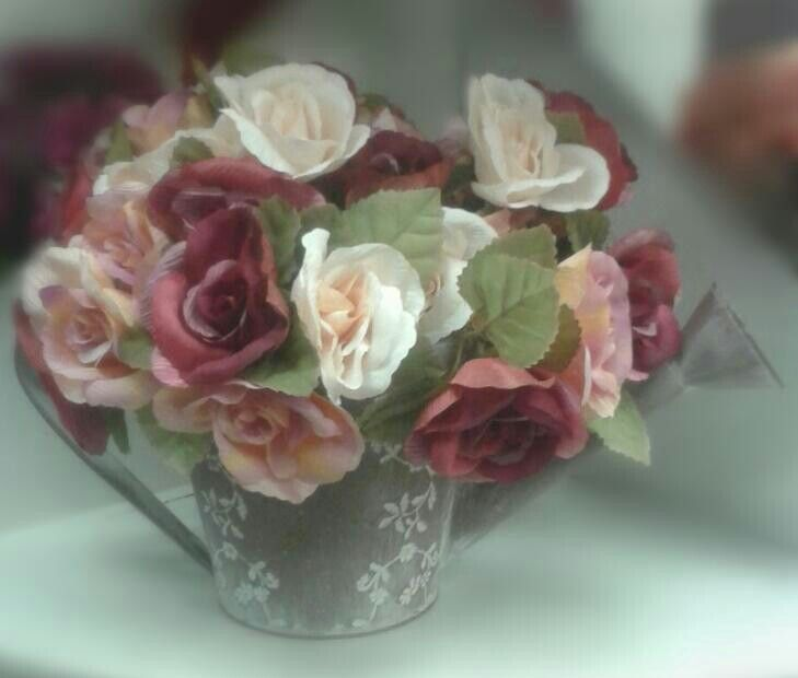 Variety of beautiful silk flowers available in store.