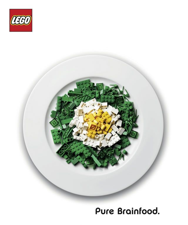 "This Lego advertisement uses legos in place of a salad to make a play on the headline, ""Pure Brainfood"". Salads are usually seen as healthy (good for you) and Legos help people create things, so Lego tries to reinforce the positive aspect of their product."