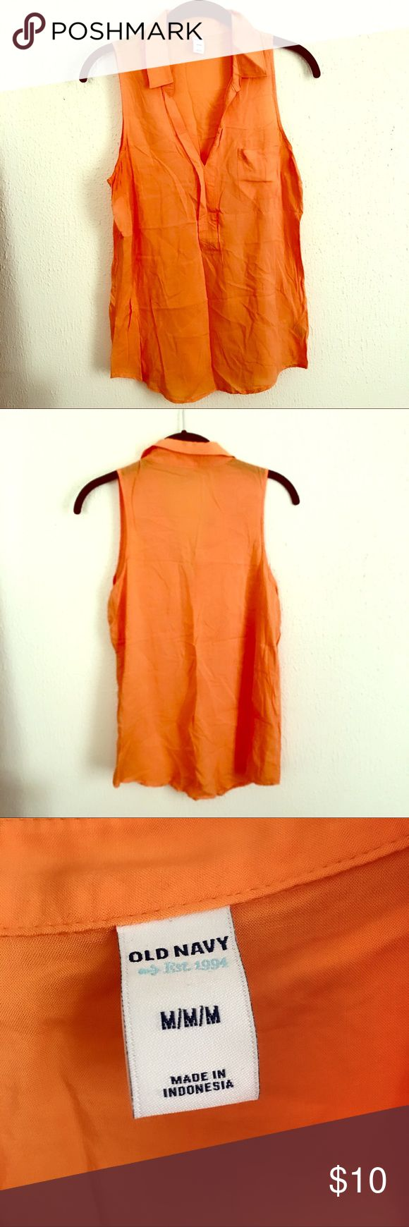 ❗️SALE❗️Old Navy Bright Orange Collar No Sleeves Lightweight silky orange sleeveless blouse with collar and buttons. Very cool on hot summer days. Note: Does wrinkle easily but takes a mere 2 mins to iron and go- or spray the wrinkle release like I do! I will iron it before it goes out. Looks super summery and sexy with white skinny jeans!!!! Old Navy Tops Blouses