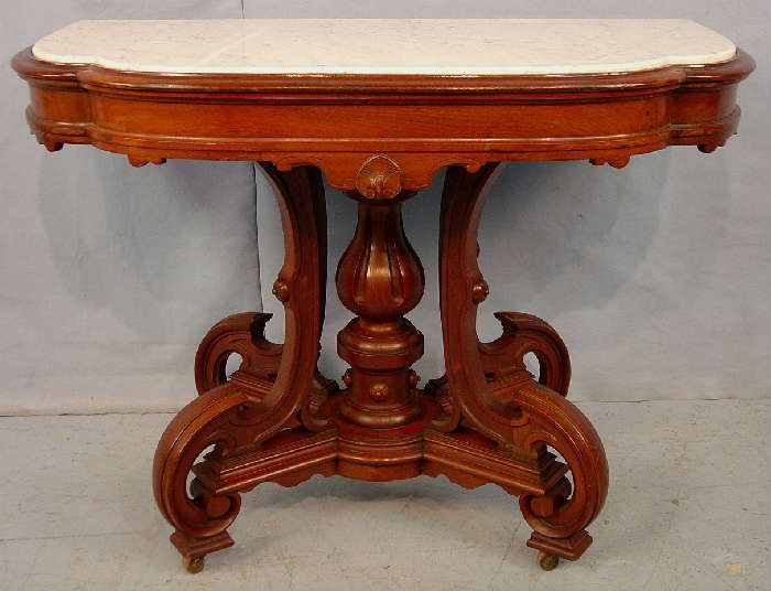 Found on EstateSales.NET: 266 - Walnut Victorian console table with insert marble and original finish, 30in. T, 22in. W, 20in. D.