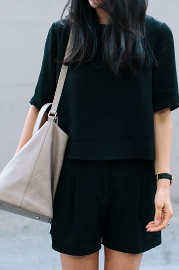 Black short sleeved blouse, black dressy shorts, black watch, light grey purse