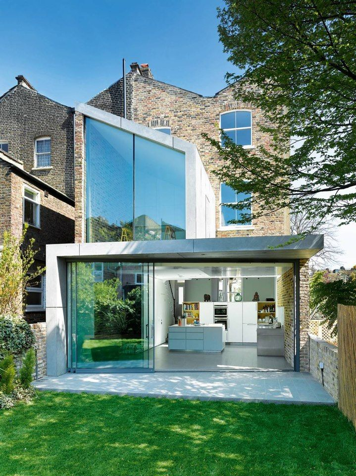 beautiful reflective glass. also very contemporary interesting shape, not the standard extension. also connected to the outside