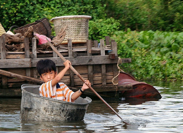 Boy in His Boat - Water Village, Cambodia