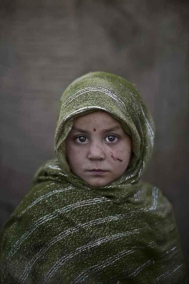 Madina Juma'a, age 4. | 21 Powerful Portraits Of Afghan Refugee Children