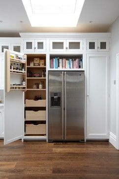 Larder cupboard and bookshelf over american fridge freezer