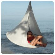"Cacoon -- hanging ""nest"" for indoors or outdoors!  Can take camping.  They also sell doors and bug nets."