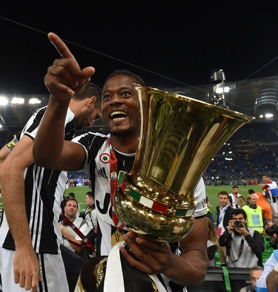 Patrice Evra of Juventus FC celebrates the victory after the TIM Cup match between AC Milan and Juventus FC at Stadio Olimpico on May 21, 2016 in Rome, Italy.