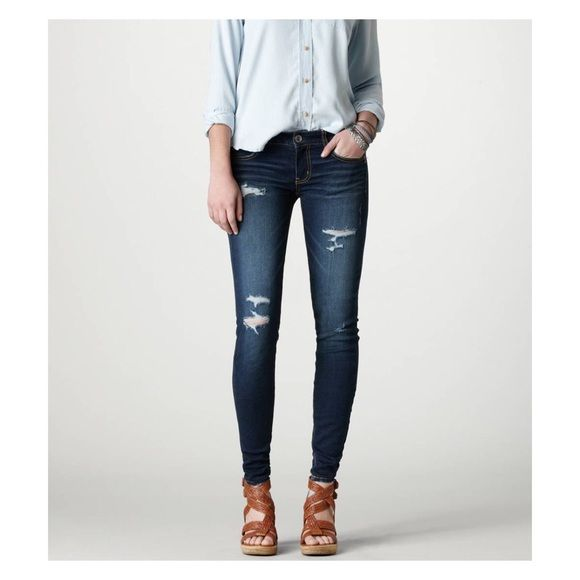 Ameican Eagle Ripped Blue jeans American eagle ripped blue jeans. Never worn. Super stretch jean. Skinny. Jeans Skinny