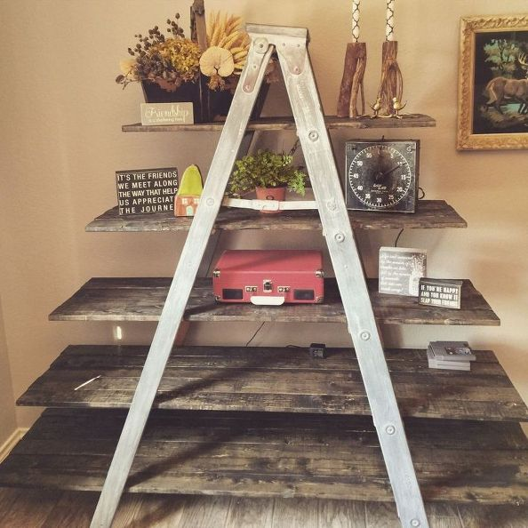 Create a unique display space with a vintage wooden ladder and some shelves