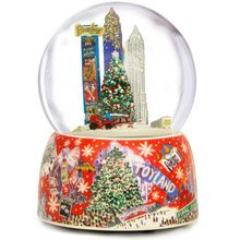 Fall in love with NYC all over again with our exquisite Christmas snow globe. The porcelain base features a lovely water color of different scenes in New York including 5th Avenue, Radio City, Central Park Carriages, Statue of Liberty, Times Square and more. Inside the oversized globe you will find Broadway, Times Square, Empire State Building and Chrysler Buildinng statues, The Rockefeller Center Tree, a snow covered bridge, plus a subway car, taxi and horse drawn carriage that rotate…
