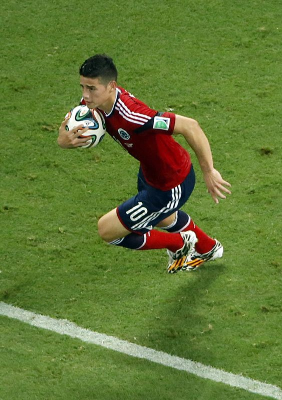 Colombia's James Rodriguez grabs the ball after scoring on a penalty during the World Cup quarterfinal soccer match between Brazil and Colombia at the Arena Castelao in Fortaleza, Brazil, Friday, July 4, 2014