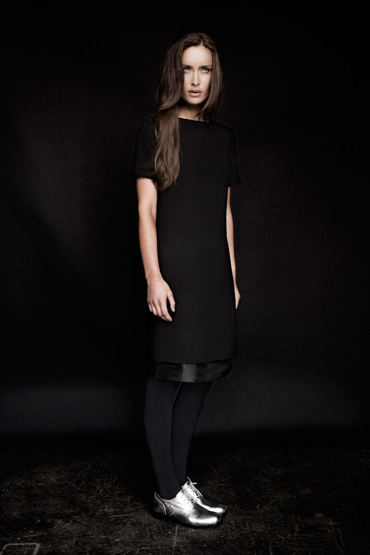 Textured, short-sleeved dress layered over black leather skirt with silver brogues, all Carolyn Donnelly The Edit