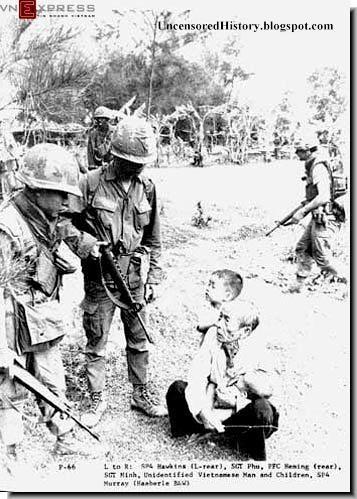 The My Lai Massacre March 1968 An old man and a child are threatened. #VietnamWarMemories https://www.pinterest.com/jr88rules/vietnam-war-memories-2/