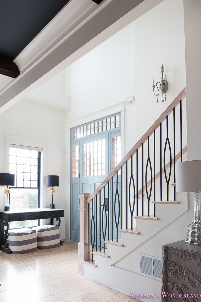 Our AMAZING new iron stair railings!... Sharing details on our beautiful new staircase balusters and a full updated foyer tour on the blog! foyer-white-walls-blue-front-foor-uncertain-grey-stardew-alabaster-sherwin-williams-iron-baluster-staircase-whitewashed-hardwood-floors