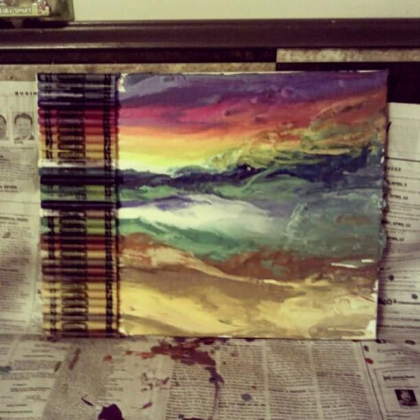 A melted crayon art piece of a sunset on the beach. This one is awesome!