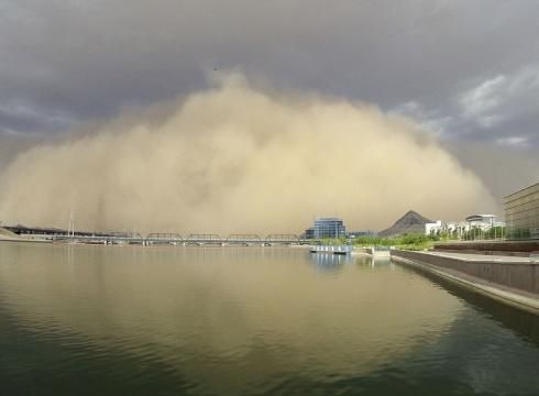 A dust storm roars through Tempe, Ariz. on Saturday, July 21. Experts say giant monsoon dust storms are becoming more frequent in Arizona. Dust storms carry a noxious mix of fungi, heavy metals from pollution, fertilizers, stockyard fecal matter, chemicals and bacteria, which can cause cardiovascular disease, eye diseases and other illnesses.