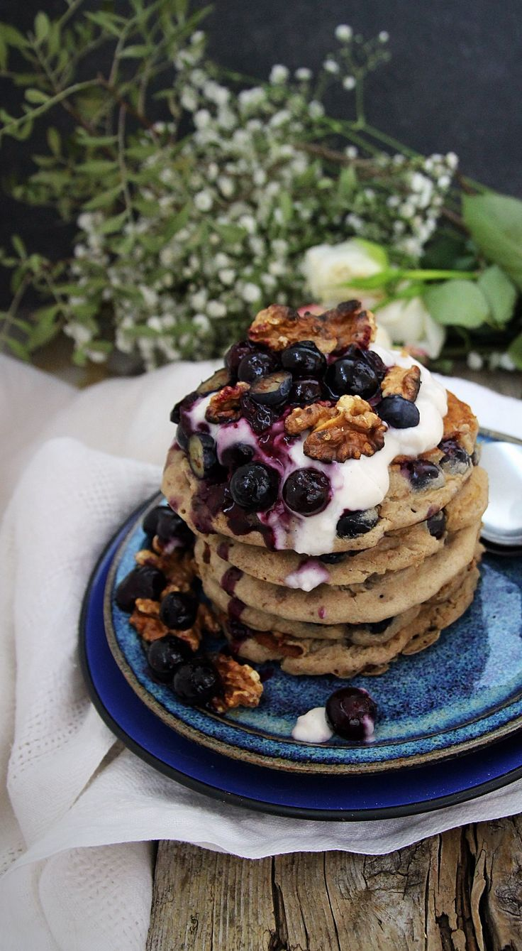 Banana blueberry buckwheat pancakes with blueberry compote, coconut yogurt and toasted walnuts.