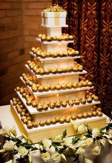 Grand gourmet chocolate candy tower perfect for wedding reception.  See more candy wedding favors and party ideas at www.one-stop-party-ideas.com