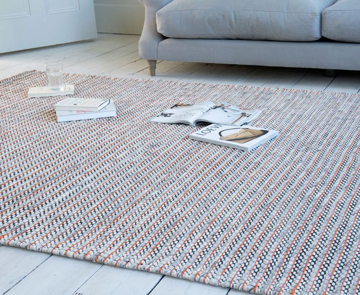 Stand at one end of Loaf's Crumbs rug and you'll behold little shots of burnt orange running through the weave. Stand at the other and you're left with a lovely neutral grey. Magic!