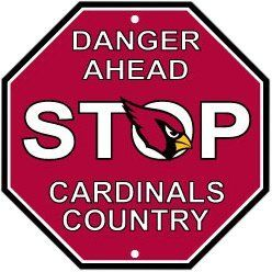 "Arizona Cardinals Plastic Stop Sign ""Danger Ahead Cardinals Country"" by Fremont Die. $12.95. Officially licensed by the National Football League. Sign measures approximately 12"" x 12"". Pre-drilled holes at top and bottom for easy mounting. Features vibrant team colors and logos. Made of durable styrene plastic. This Arizona Cardinals stop sign is made of durable styrene plastic and measures approximately 12"" x 12"", the same size and shape as a real stop sign. Reads..."