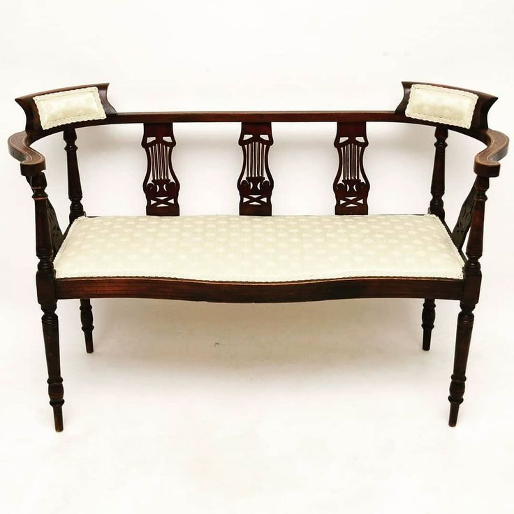 Antique Edwardian Inlaid Mahogany Settee at Marylebone Antiques | This is an antique Edwardian mahogany settee with some fine satinwood inlays. It's in good original condition & is being presented just as we acquired it. The upholstery is in good condition & the frame is sturdy. This settee has finely turned legs & uprights with shaped fretwork supports between the back & the seat. In fact if you look closely at the fretwork designs you can make out an Art Nouveaux influence. I've only just…