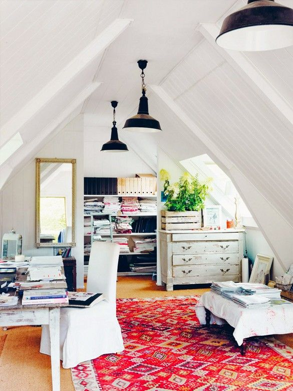 Antique drawer, modern lamps, and bright rug