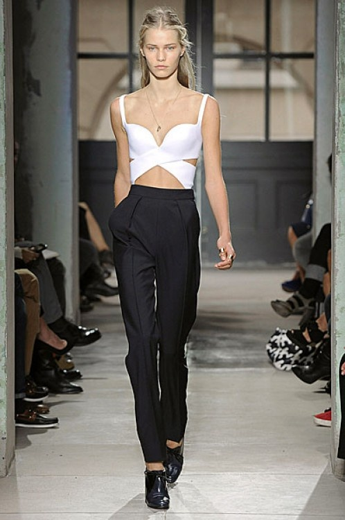 Balenciaga designed this look for Paris Fashion week Spring/Summer 2013 with a high waisted black trouser pant and a cut out white top.