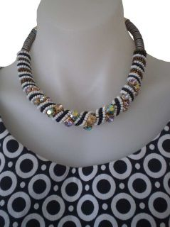 Black and white beading rolled onto a multicoloured rope gives this necklace a striking contrast.  Add a handful of sparkly coloured faux diamantes and you're ready to rock.    Perfect to jazz up your black (or white) wardrobe pieces without adding intense colour.  Measures 35cm end to end.  Rolled portion is approx 1.8cm thick.