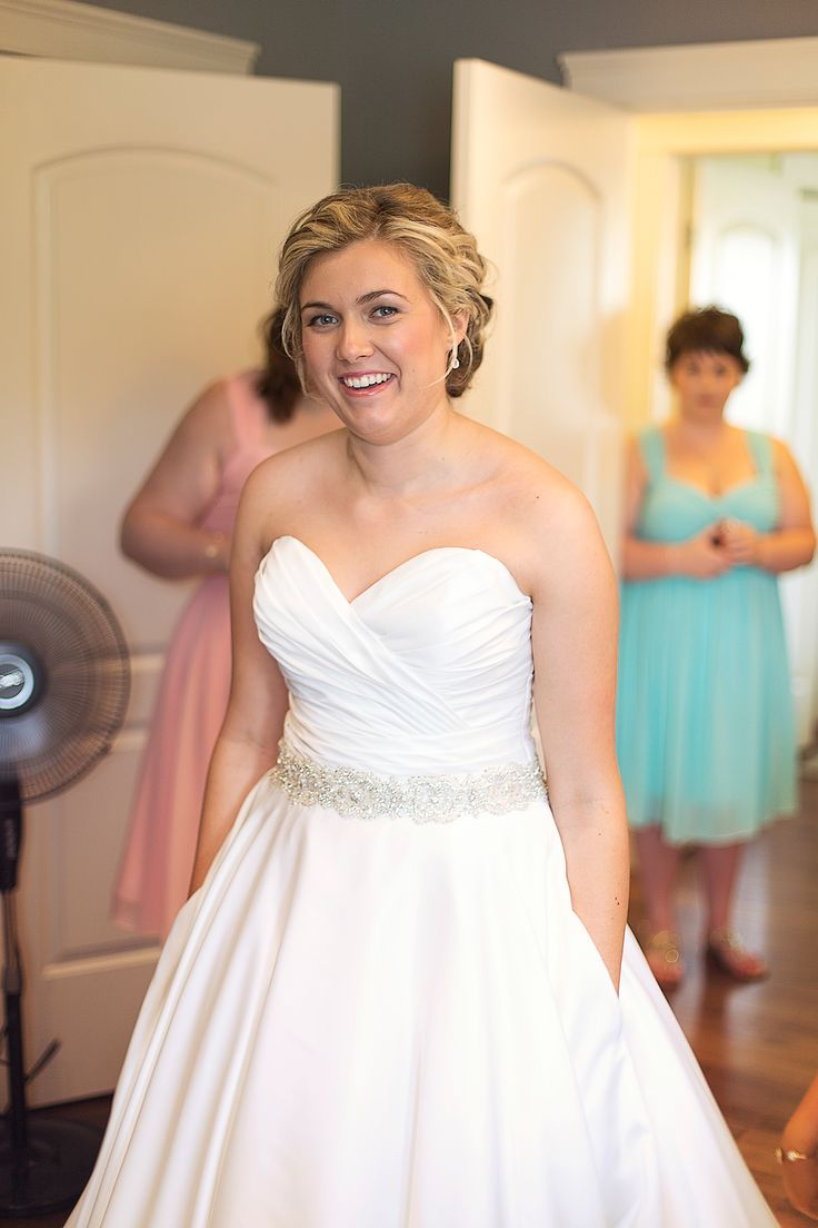 Wedding dress from Allure Bridal; Satin white dress with pleating on top, bling belt (comes with belt attached) and pockets from The Wedding Loft, Miramichi, NB; Earrings from Swarovski; Photo cred: Hillary McCormack Photography