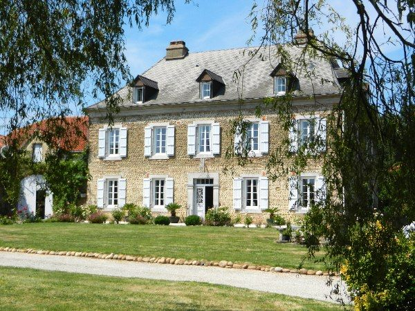 An imposing country manor house with an elegant for French country style homes for sale