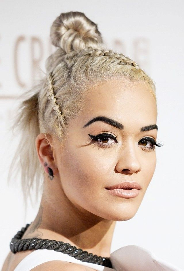 Loving Rita Ora's boxer braids, top knot and perfectly flicked eyeliner