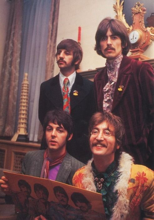 The Beatles introducing Sgt. Pepper's album to the press at Brian Epstein's house. May 1967