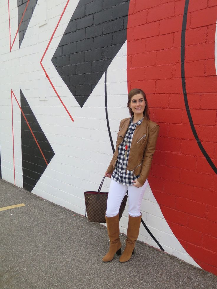 Dressing for chilly spring or fall weather in a camel leather jacket, gingham, white jeans and OTK boots
