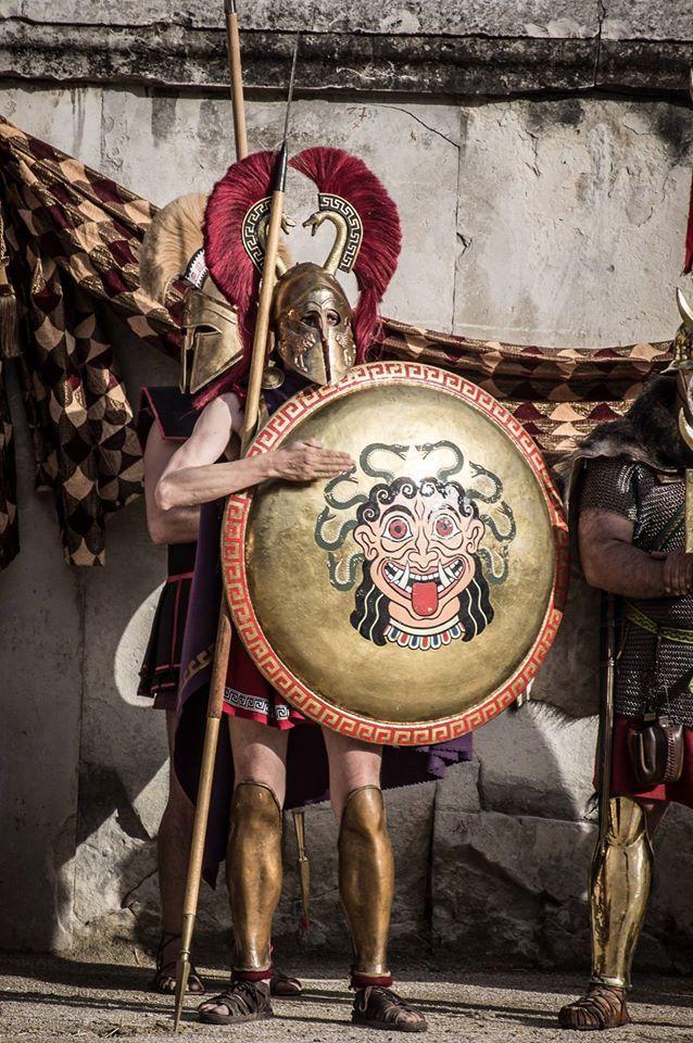 Hoplite reenactor wearing a double serpent crested Corinthian helmet.