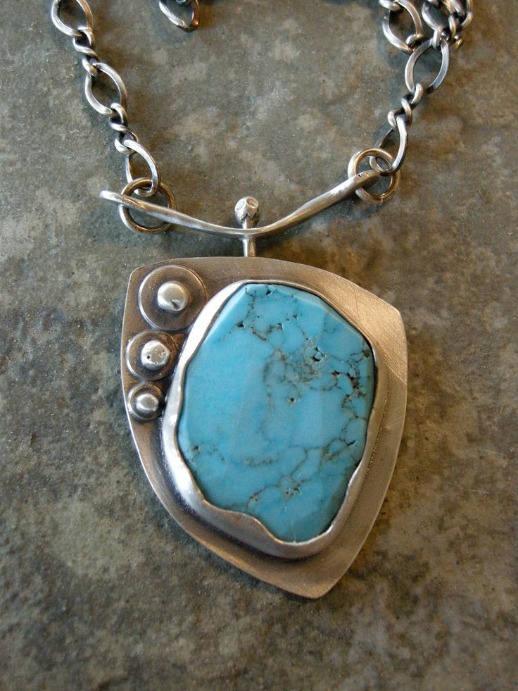 Turquoise pendant with sterling silver bezel and chain.. $125.00, via Etsy.