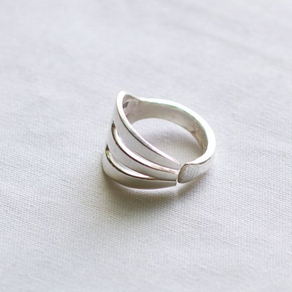 This silver plated ring was made from a cocktail or seafood fork. The tips of the tines are ground down and pulled together before shaping into the ring. These are made when ordered and may vary in shape of tines and pattern on band. This ring is available in whole and half sizes 5-11 All metals used to handcraft our rings come from recycled/reclaimed silverware. Our rings are made by hand in our workshop in Kentucky.