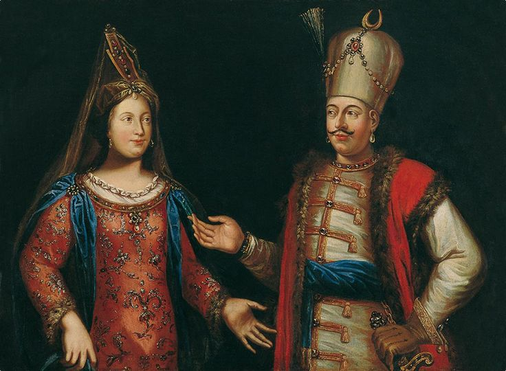The painting depicts an Ottoman sultan and his haseki in front of a dark background. The two have their hands extended towards each other. The sultan is wearing a red kaftan with fur trimming, over a bejewelled robe with gold embroidery.