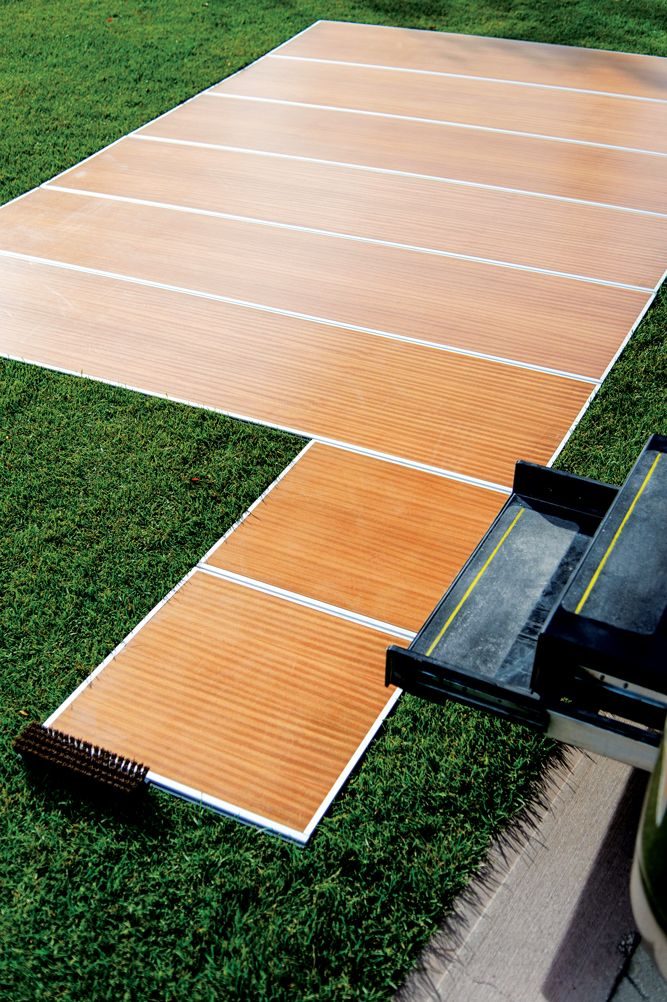 The RV Deck from Decked Out RV Products is an alternative to that roll of green indoor/outdoor carpet for your patio activities. The RV Deck is 93 inches wide and is available in lengths of ...