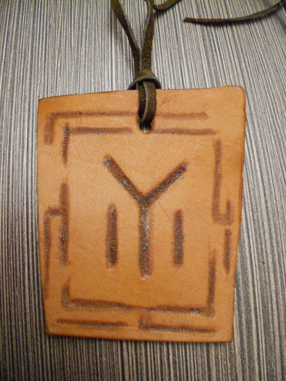 Leather medallion with a relief image of Old-symbol IYI