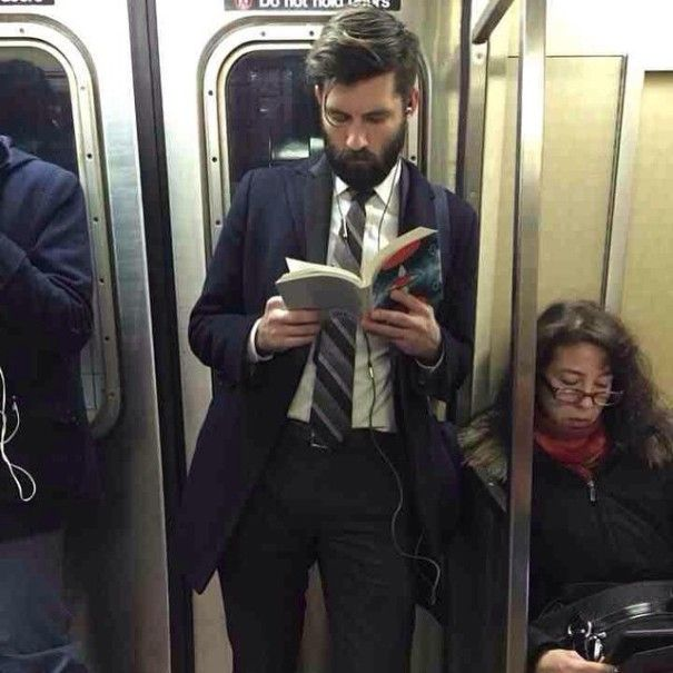 A blog post dedicated to pictures of hot guys reading on trains. In case you need a distraction from your day.