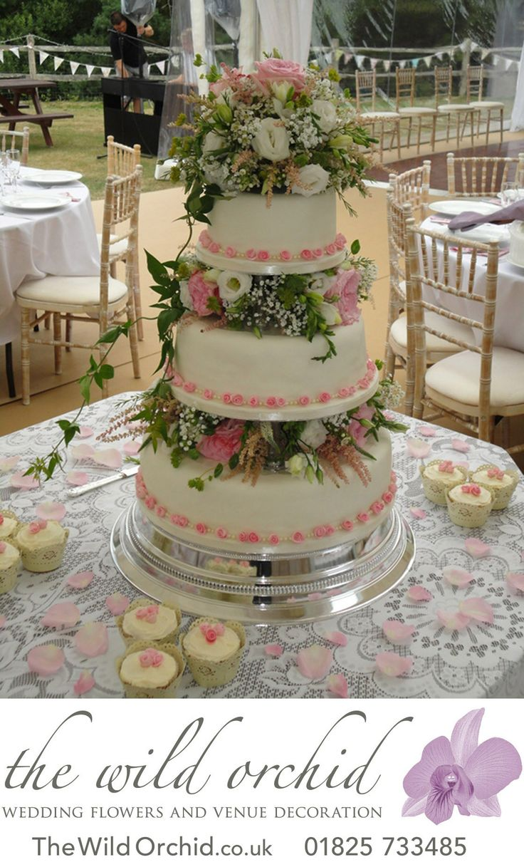 17 best images about more wedding flowers popular beautiful fresh flowers in ivory pinks and creams decorate this three tier cake